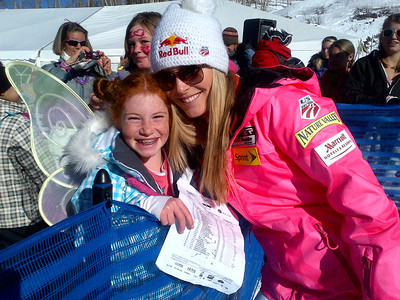 Lindsey Vonn poses with a young fan wearing wings after her historic super G win at Beaver Creek (U.S. Ski Team/Doug Haney)