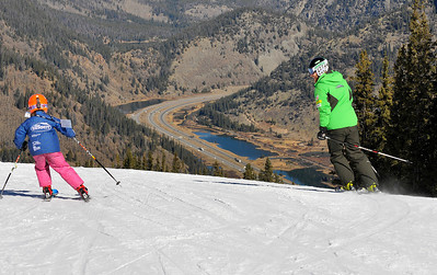 7-year-old Alex Westall from Team Summit gets the thrill of a lifetime skiing with U.S. Ski Team star Will Brandenburg on opening day at the U.S. Ski Team Speed Center at Copper. (Tom Kelly/USSA)