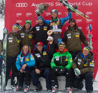 VAL GARDENA, ITALY - DECEMBER 15: The US Speed Team join Steven Nyman on the podium after he won the Audi FIS Alpine Ski World Cup Downhill race on December 15 2012 in Val Gardena, Italy. (Photo by Mitchell Gunn/ESPA) Image may be used for editorial use only.