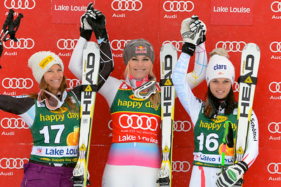 Lindsey Vonn stands atop the podium in the Audi FIS World Cup super G in Lake Louise. Photo © Roger Witney/Alpine Canada Image may be used for editorial use only.