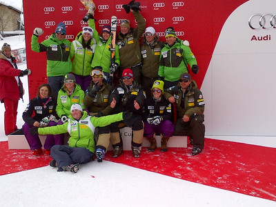 The women's U.S. Ski Team celebrates on the podium with Leanne Smith after her second place finish in the Val d'Isere downhill (U.S. Ski Team)