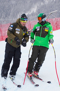 KITZBUHEL, AUSTRIA - JANUARY 25: US Ski team head speed coach Andreas Evers, and Travis Ganong during the pre race course inspection prior to the Audi FIS Alpine Ski World Cup SuperG on January 25, 2013 in Kitzbuhel, Austria, (Photo by Mitchell Gunn/ESPA) Image may be used for editorial use only.