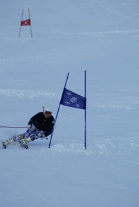 Julia Mancuso rips a giant slalom turn while testing out her new Head equipment at Mt. Hutt (Mt. Hutt)