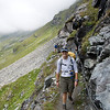 Hiking toward Louvie Hut along the historic Haute Route. The scenery is filled with glacial rock.
