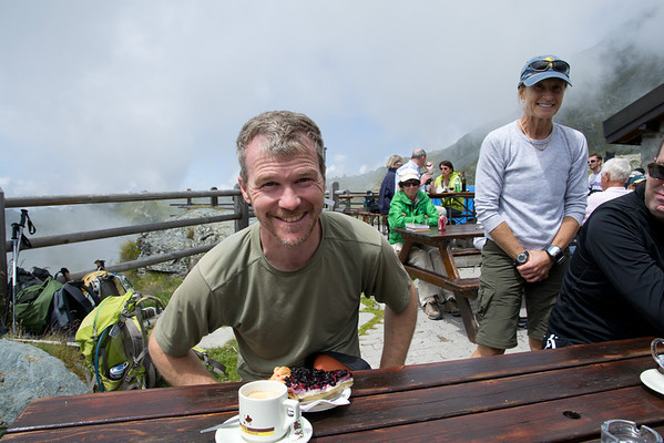 Troy Haines, Alpinehikers Owner & Guide, doing what he most enjoys about hiking: stopping for a Kaffee & Torte! Having a rest at Mont Fort en route to Louvie Hut.