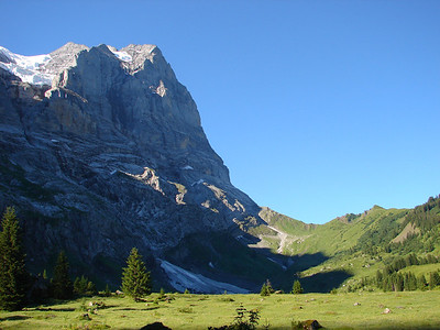 The Wetterhorn rises above Grosse Scheidegg pass on your hike to Grindelwald from Schwarzwaldalp