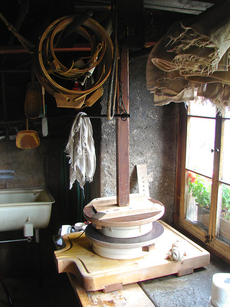 Fresh alpine cheese being pressed at Obersteinberg.