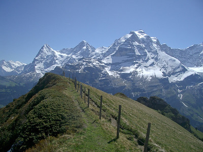 Eiger, Monch and Jungfrau mountains viewed from the Wasenegg ridge above Murren.  Spectacular!