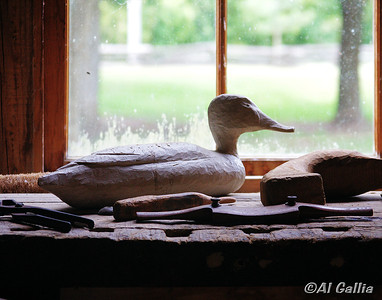 "©Al Gallia; ""Work in Progress""; Unfinished duck carving in Le Magasin (storehouse) at Vermilionville, Louisiana."