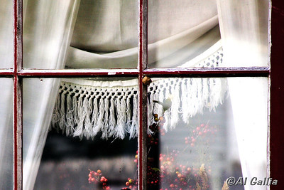 "©Al Gallia; ""The Fringed Swag""; Reflections in old, weathered historic Acadian home window with fringed swag drapes. Captured during walkabout at Vermilionville Cajun/Creole Heritage Park in Lafayette, Louisiana."