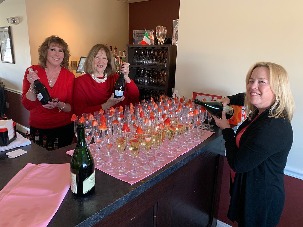. Pouring a little bubbly are the most popular people in the house, from left, Barbara Farley of Lowell, Libby Gaffney of Dracut and Liz Flanagan of Andover