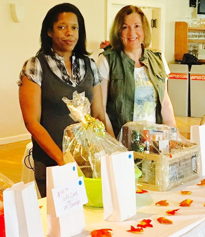 . Board members Shannon Anderson of Malden, left, and Lorna Garey of Tewksbury