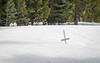 Cross Half-Buried in Snow