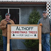 Ron (left) and Tony Althoff (right) have seen an increase in their sales of natural trees this year. They have sold three times more big trees this year than last year. photo Crystal Reed.