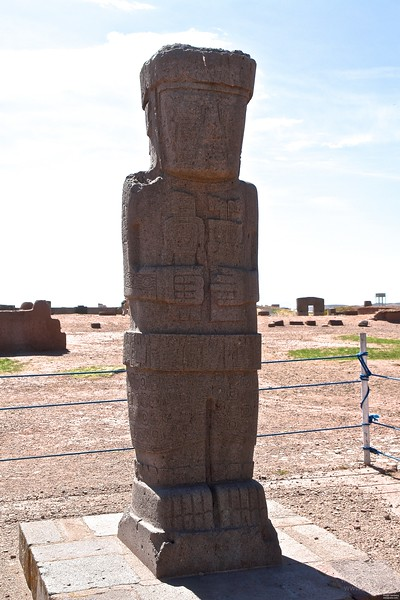 "Tiwanaku. ""El Fraille"", the monk. Volcanic rock. He is wearing the very same goggles like the statue on the Gate of the Sun and again some double headed thing in his left hand. In his right hand maybe a kind of human puppet. Take a close look: he has two left hands. His head is protected with an open helmet design."