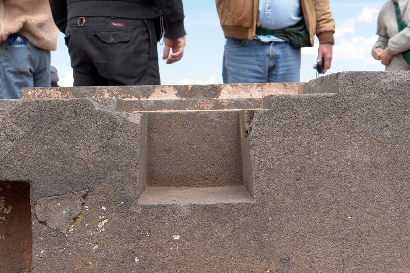 Tiwanaku. All those flat surfaced cavities are of trapezoid shape.