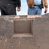 Tiwanaku. All those flat surfaced cavities are of trapezoid shape.