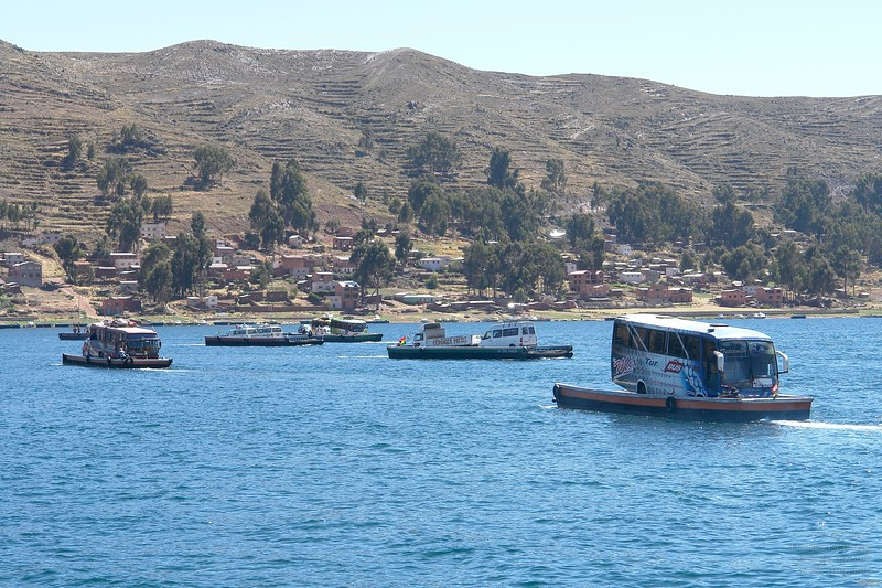 Heavy traffic on a narrow strait on lake Titicaca on the way to Tiwanaku.