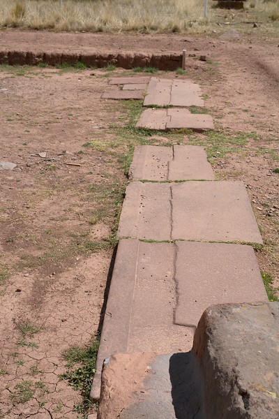 Tiwanaku. Hints for plasticine like stone during construction as the upper layer of bricks made an imprint into the foundation made from red sandstone.