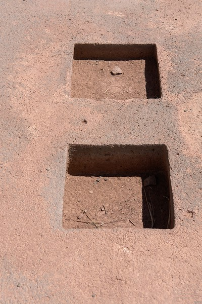 Tiwanaku. Trapezoid shape again. The side length of the square holes is widening with depth.