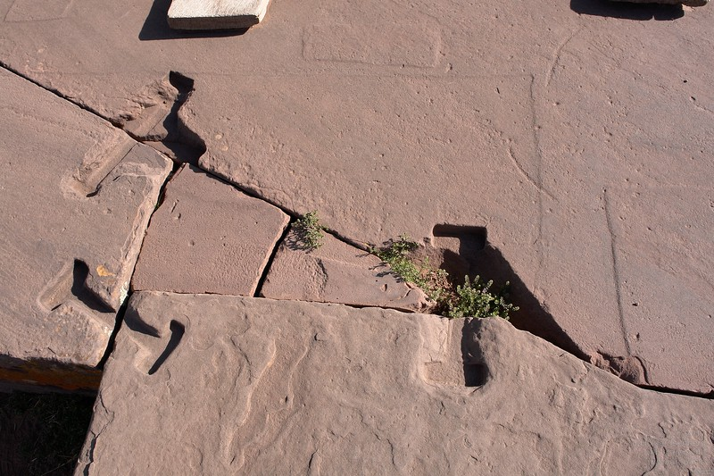 Puma Punku. Huge sandstone paving blocks have been connected by metal clamps. Normally, those clamps are made from metal poured into the stone cavities. Here the process was most likely inverted: a fabricated metal clamp was pressed into a plasticine like stone, like into wet concrete.