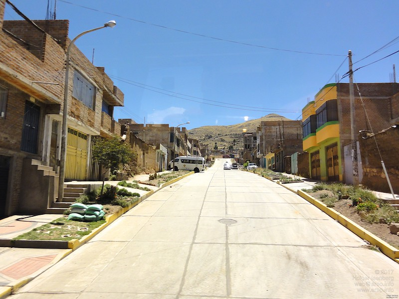 Puno. The streets and sidewalks in Peru and Bolivia are always swept meticulous clean.
