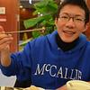 Wei Sun '13 enjoying Chinese dumplings!