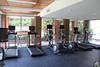 8/17/2011- Four treadmills and two elliptical machines equipped with large screen monitors line the wall facing the pool.