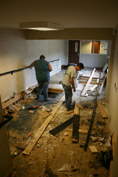 Workers remove the stairs and ramp in the hallway between the records office and hotel. 10-22-09