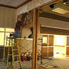Workers remove the door frames separating the lobby from the old snack bar. - 10/27