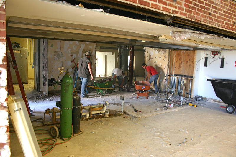 Workers continue removing walls in the former alumni center kitchen. 11/2/09