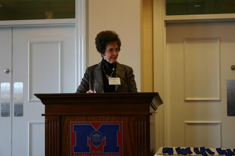 Aleita Sullivan, President of the Law Alumni Chapter, emcees the program