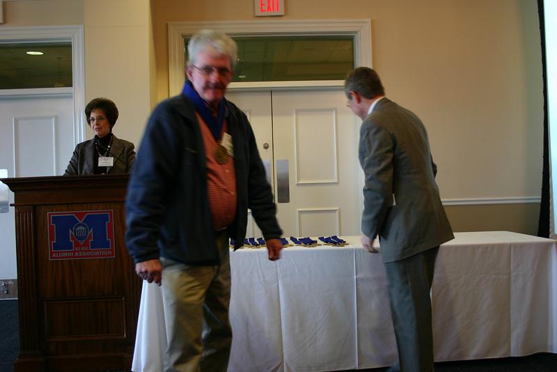 Hon. Michael Corrigan (LL.B. 60) receives his medallion