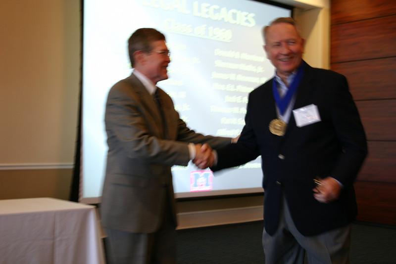 Dean Sam Davis congratulates Pat Scanlon (LL.B. 60)