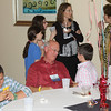 MS Bar President-Elect Guy Mitchell (JD 68) enjoys time with his grandchildren at the dessert party