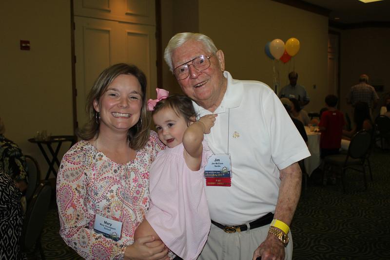 Mary Thompson (MEd 08) and daughter, Lucy, with Jim McClure (LLB 53)