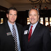Bill Howard (JD 79), here with Jamie White (BA 96, JD 00), was one of the luncheon's sponsors.