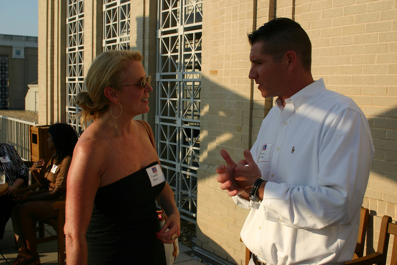 Elizabeth Horton (MBA 96, JD 98) visits with UM Law development officer Jamie White (BA 96, JD 00)