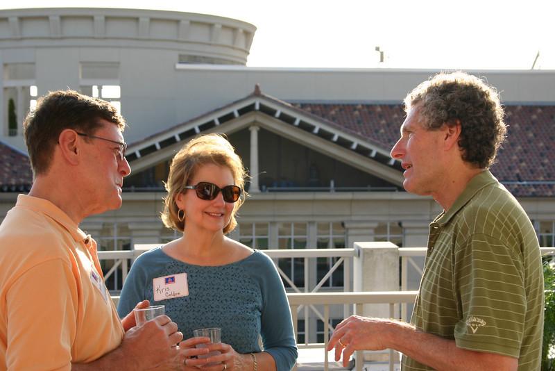Wilson (BPA 70, JD 77) and Kris Golden visit with Dean Richard Gershon