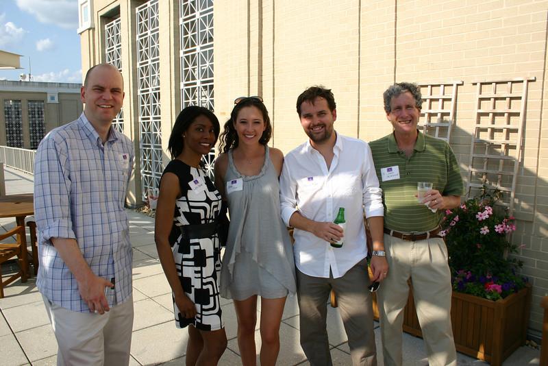 Steve Woodliff (JD 10), Lynn Parker (JD 06), Ashley Frye (BBA 08, MBA 09) and Kevin Frye (JD 05) with Dean Richard Gershon
