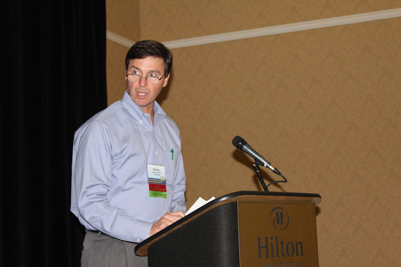 Bobby Bailess (BBA 73, JD 76), president of the Law Alumni Chapter presides over the annual luncheon's business session