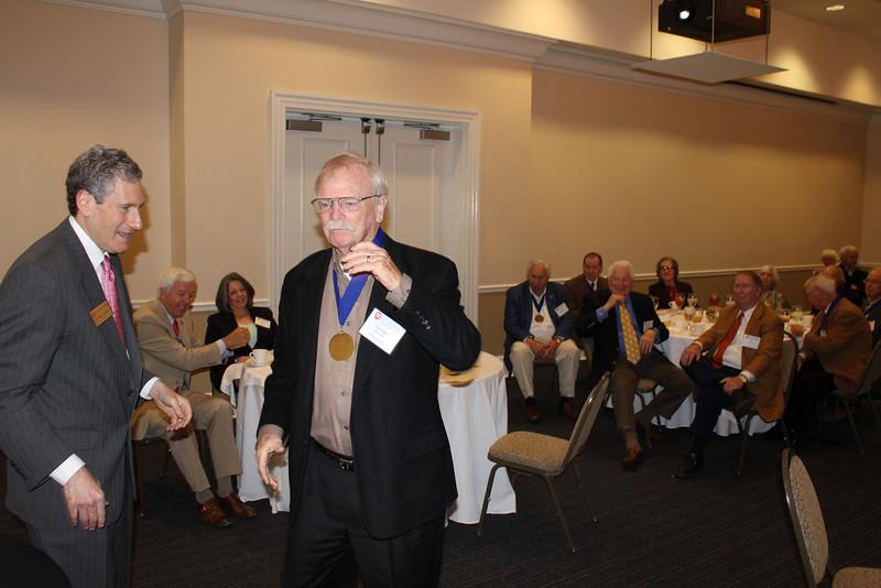 George Shaddock (LLB 63) receives a Legal Legacy medallion.
