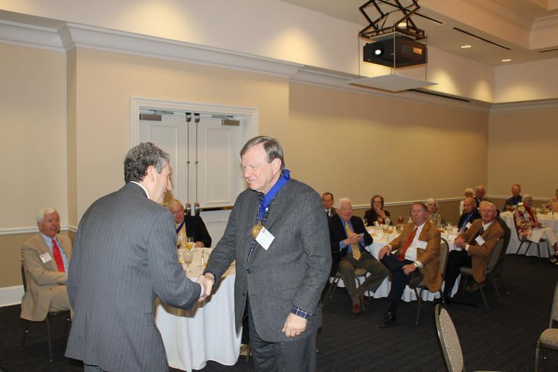 Dean Gershon congratulates Jim Herring (LLB 63) after presenting him a Legal Legacy medallion.