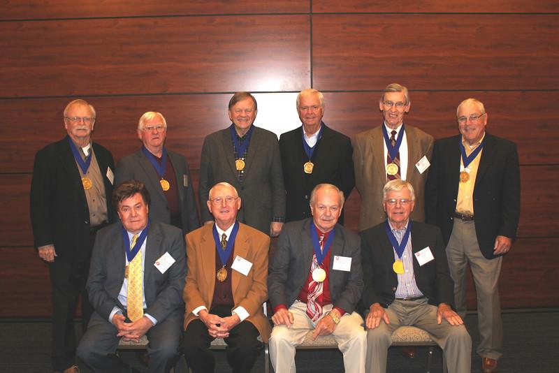 Legal Legacy medallion recipients this year include (front row l-r): John Arthur Eaves (LLB 63), Ted Jones (LLB 63), Herbert Stelly (LLB 63) and Sandy Sams (LLB 63). (back row l-r): George Shaddock (LLB 63), Harold Barkley (LLB 63), Jim Herring (LLB 63), Joe Meadows (LLB 63), Ottis Crocker (LLB 62) and Walter Gex (LLB 63).