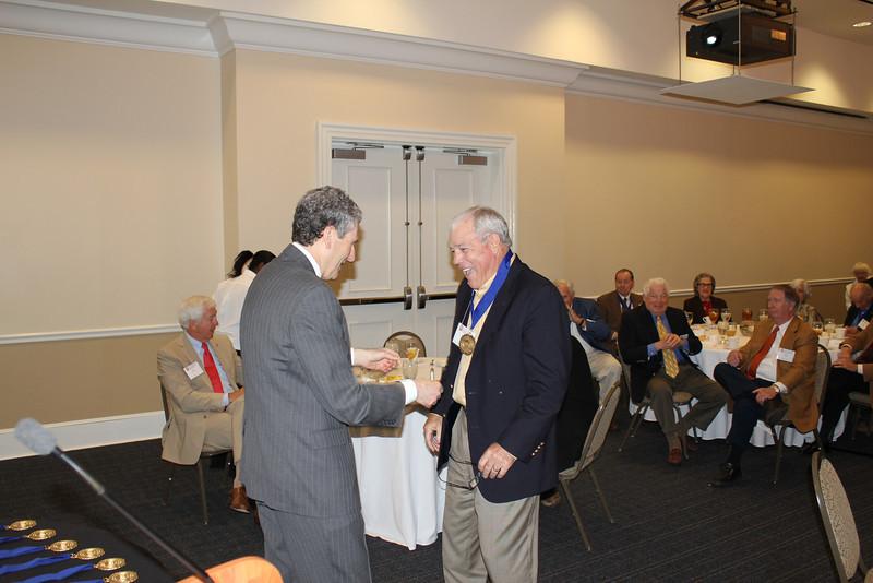 Dean Gershon presents Judge Walter Gex (LLB 63) a Legal Legacy medallion.