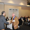 Dean Gershon congratulates Ted Jones (LLB 63) after presenting him a Legal Legacy medallion.