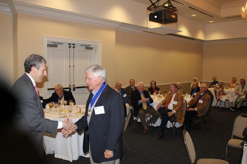 Dean Gershon congratulates past Lamar Order Chairman Sandy Sams (LLB 63) after presenting him a Legal Legacy medallion.