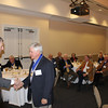 Dean Gershon congratulates past Lamar Order Chairman Sandy Sams (LLB 63) after presenting him a Legal Legacy medallion.
