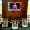Etched, crystal ice buckets are presented to Law Alumni Hall of Fame recipients.