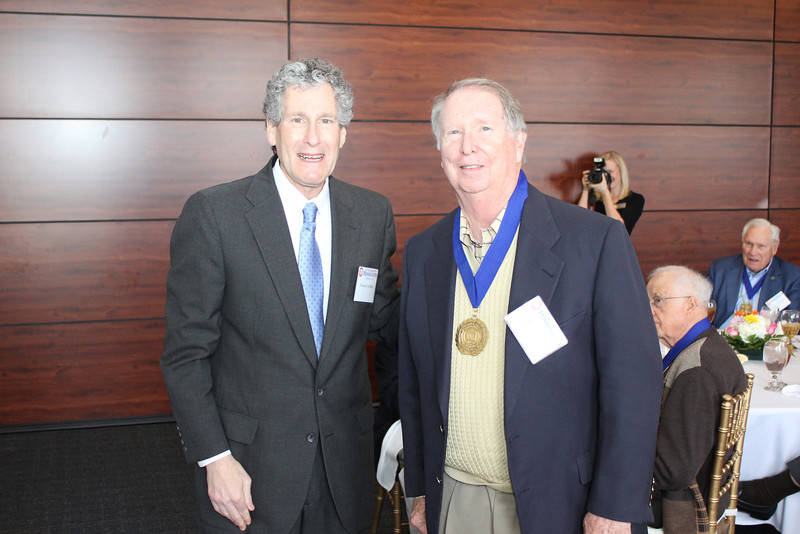 Dean Gershon presents the Legal Legacy medallion to Roger Flynt (LLB 64)